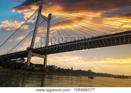 Vidyasagar Setu (bridge) as seen from a boat on river Hooghly at dusk.
