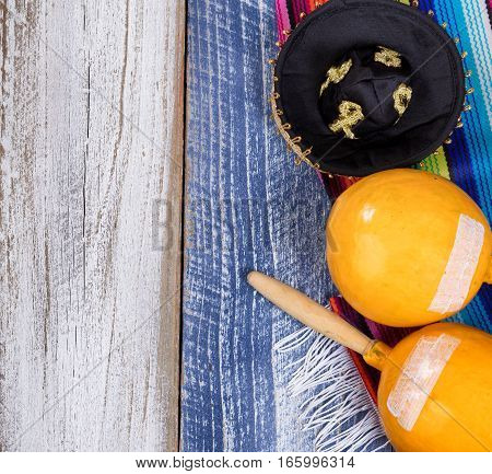 Cinco de Mayo concept with Mexican maracas sombrero and placemat serapes.