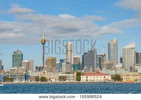 SYDNEY AUSTRALIA - OCTOBER 13 2016 : Panorama of Sydney waterfront and skyline with Garden Island Wharf in foreground.