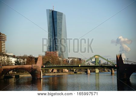 The high-rise building and the headquarters of the European Central Bank behind the Old Bridge in Frankfurt.