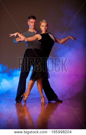 Beautiful Ballroom Couple Preforming Their Pasonate Exhibition Dance