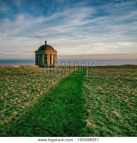 Mussenden Temple perched dramatically on a 120 ft cliff overlooking Downhill Beach.