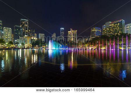 Kuala Lumpur Malaysia City Skyline from KLCC Park by Symphony Lake at Night