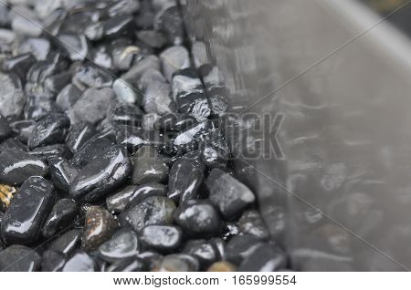 Pebbles around a Steel Edge Water Feature
