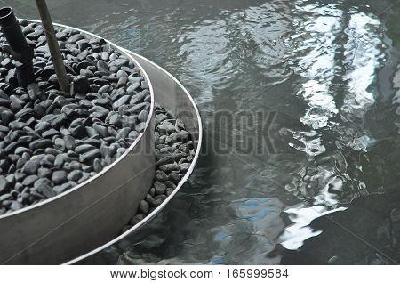 Circular Planter Edge Detail on Relfective Pool