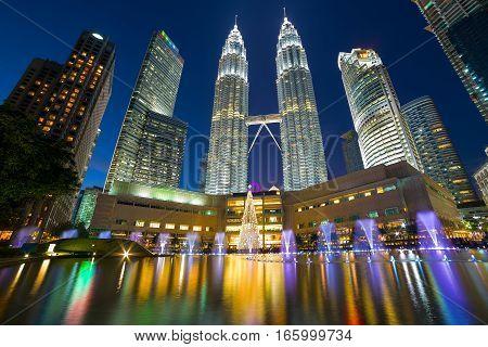 Kuala Lumpur Malaysia modern city skyline at KLCC Park by Symphony Lake at Night