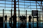 travelers silhouettes at airport poster