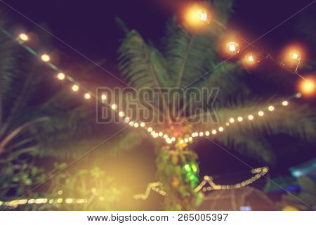 Blurred Light Bokeh With Coconut Palm Tree Background, Yellow String Lights With Bokeh Decor In Outd