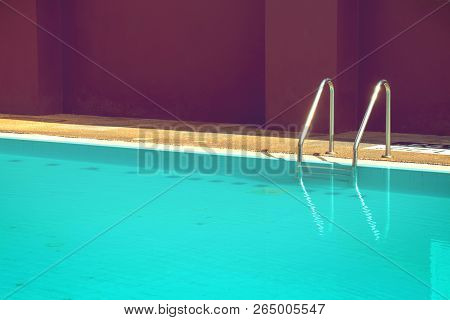 Staircase Pool Or Pool Ladder, Outdoor Swimming Pool In Old Hotel With Brown Wall