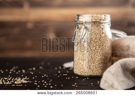 Raw quinoa seeds in a glass jar