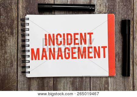 Word Writing Text Incident Management. Business Concept For Process To Return Service To Normal Corr
