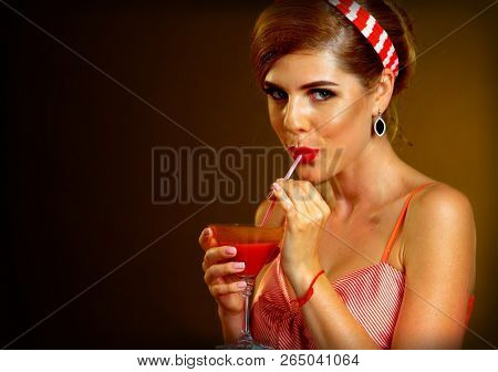 Retro woman with music vinyl record. Pin up girl drink martini cocktail. Girl pin-up retro style wearing red dress on dark background. Illegal alcohol at party.