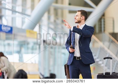 Business man in the airport terminal on business trip on arrival or when changing trains