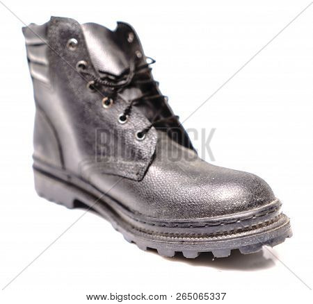 Black Safety Shoe On White Background, Safety Shoes For Workers Wearing A Personal Protective Equipm