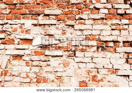 Stone texture background of red brick wall, texture of stone red bricks. Weathered stone wall made of red bricks, stone texture background