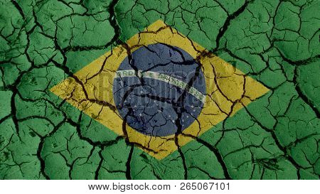 Political Crisis Or Environmental Concept: Mud Cracks With Brazil Flag poster