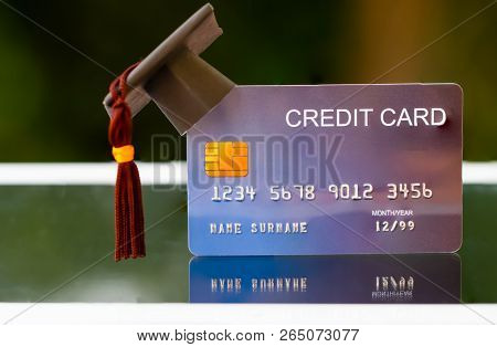 Education Payment Credit Card For Study Graduate Concept: Graduation Cap On Mock Up Card, Idea For D
