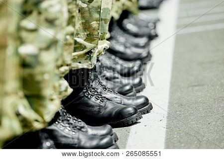 One Step Ahead, Military Army Boots In Row