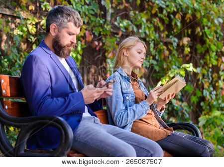 Man With Beard And Woman Read Alternative Information Storage. Reading Hobby Concept. Read Book In P