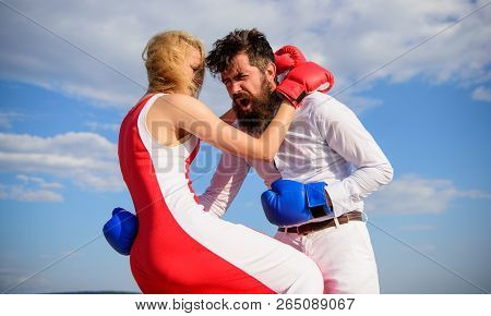 Learn How To Defend Yourself. Man And Woman Boxing Gloves Fight Blue Sky Background. She Knows How T