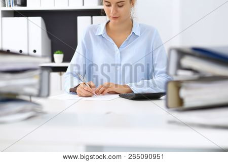 Unknown Female Bookkeeper Or Financial Inspector Calculating Or Checking Balance, Making Report, Clo