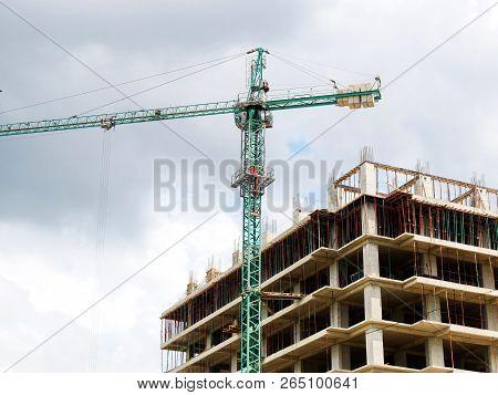 Construction Site. Construction Site With Crane And Building. Self-erection Crane Near Building.