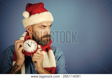 Christmas Countdown To Midnight. Time To Celebrate Concept. Hipster In Santa Hat, Scarf On Blue Back