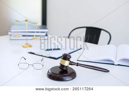 Attorney's Suit, Law Books, A Gavel And Scales Of Justice On A Wooden White Desktop, Lawyer And Just