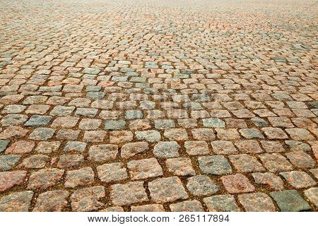 Wet Gravel On The Ground. Wet Road Of Stones. Natural Background.  Natural Paving Granite On Road. W