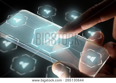 transportation, rental service and future technology concept - close up of hand with transparent smartphone and virtual car sharing icons over black background,