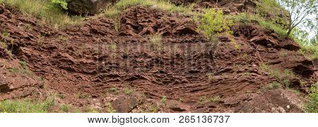 detail of geological structure which is a border between Variscan orogeny and perm and trias sediments inside of former red sandstone quarry in zachelmie in holly cross mountains in poland poster