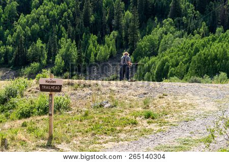 Hayden Trailhead Sign Near The Red Mountain Creek, Near Ouray Colorado. Unidentifiable Fisherman Cas