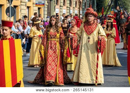 ALBA, ITALY - OCTOBER 01, 2017:  People wearing historic dresses on Medieval Parade - traditional part of celebrations during annual White Truffle festival taking place each year in Alba, Italy.