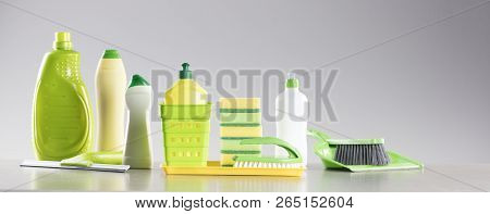House And Office Cleaning Up Theme. Set Of Different Colorful Cleaning Products In Bottles And Spong