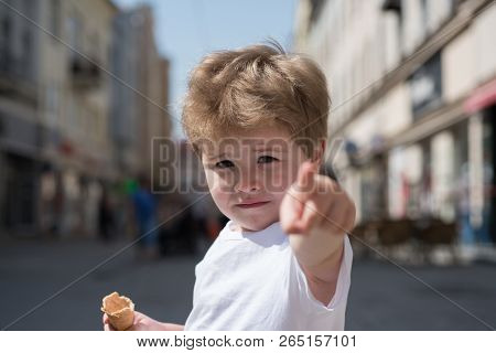 I Choose You. Little Boy Point Finger On City Street. Small Child With Stylish Haircut. Little Child