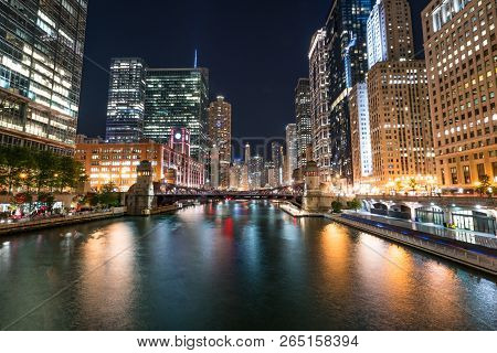 Downtown Chicago City Skyline Along The Chicago River At Night