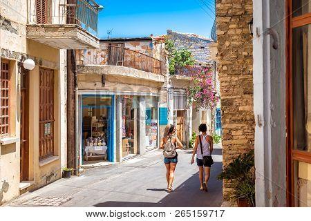 Pano Lefkara, Cyprus - June 17, 2018: Girls Walks Through A Village.