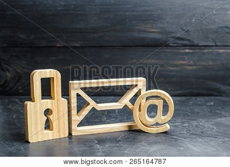 Wooden Padlock Stands Next To The Email Envelope. Concept Of Protection Of Personal Data Trade Secre