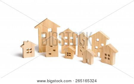 City Of Wooden Houses On A White Background. The Concept Of Urban Planning, Infrastructure Projects.