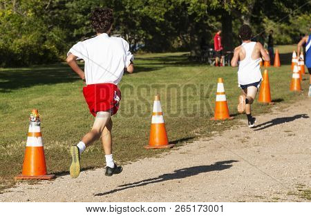 Freshmen Boys High School Cross Country Runners Racing The Final 300 Meters Of A Cross Country Cours