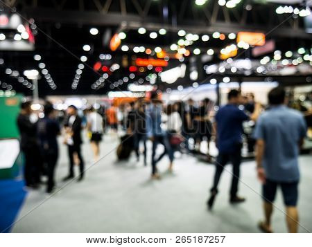 Background Is Out Of Focus And Blurred At The Auto Show. Blur The Background Of The Motor Expo. Abst