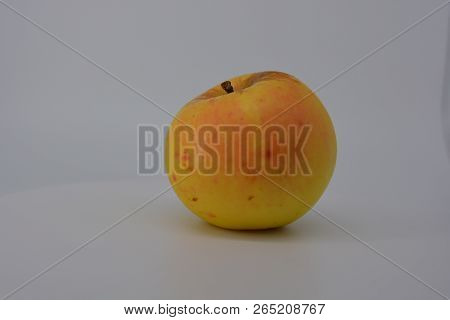 Beautiful Fresh Tasty Edible Yellow Apple In Autumn With Red Barrels And Red Dots In Autumn On A Whi