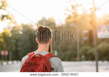 Casual Man With Backpack. Sport Fitness Trekking And Athletic Active Lifestyle Concept.