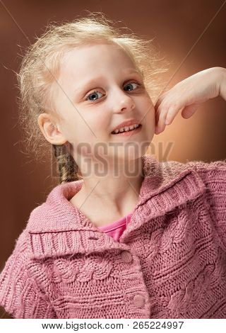 Portrait Of Smiling Little Blond Girl's Waist On The Root Background