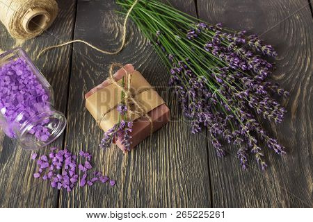 Top View. Handmade Soap, Fragrant Bath Salt And Fresh Lavender On Dark Boards
