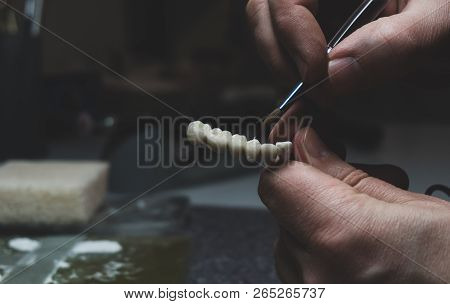 A Dental Technician Makes A Prosthetic Teeth. Laboratory. Close-up.