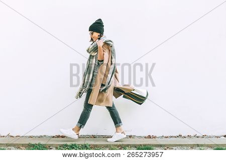 Woman In Trend Multilayered Outfit Walks In Autumn City Street. Fashion Street Trends