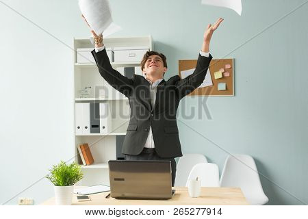 Business People, Joke And Fun Concept - Young Handsome Man In Suit Having Fun In The Office