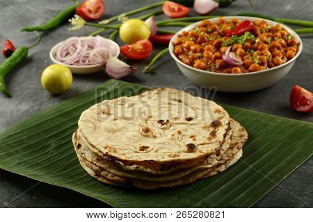 Homemade Chapati Bread Served With Channa Masala , Indian Food Background.