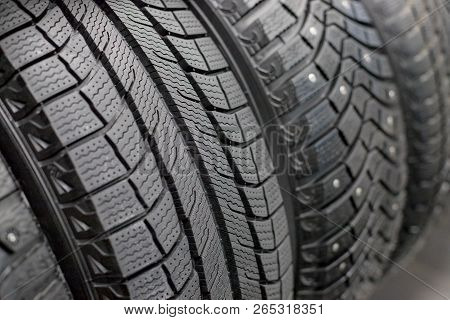 New Black Car Tire, Closeup.brand New Winter Tires With A Modern Tread Isolated.selective Focus.tire